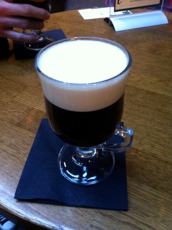 A delicious Irish coffee with fresh cream on top