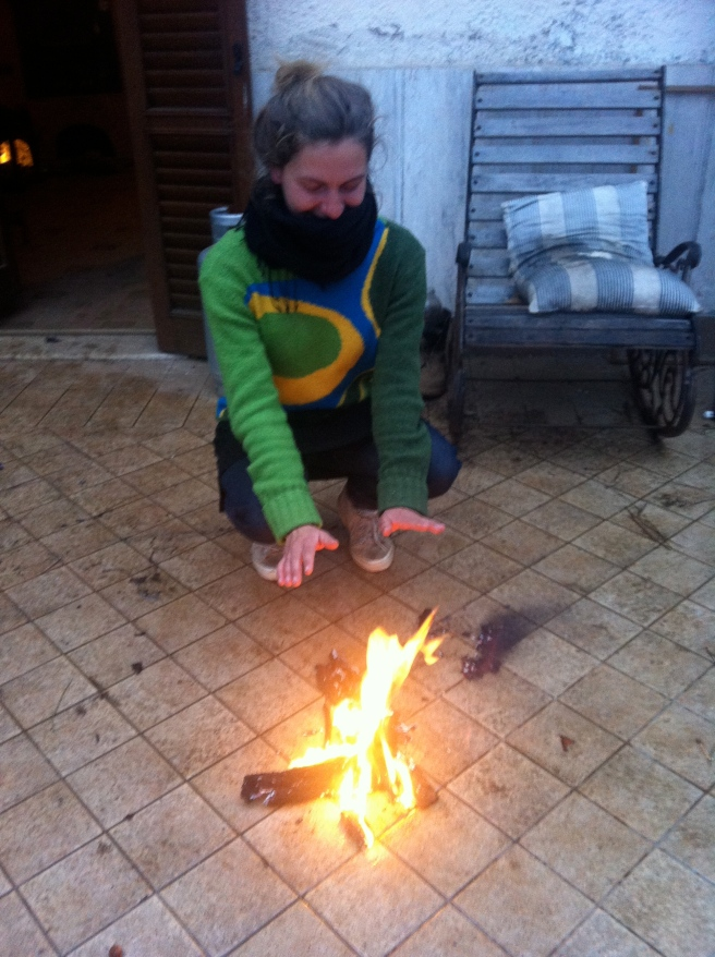 Justina warming her hands on our makeshift bonfire on the terrace