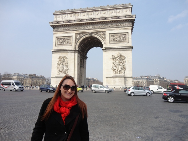 Smiley me in front of the Arc de Triomphe