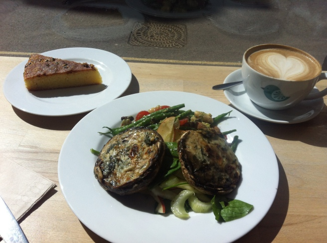 Rarebit mushrooms stuffed with goatcheese and spinach with an apple salad and a mixed bean salad.  With  a side of gluten free passionfruit cake. YUM.
