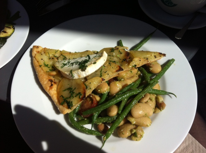 Potato, rosemary, and brie tart with a mixed bean salad.
