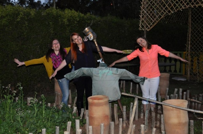 Goofing around with the scarecrow in the kitchen garden