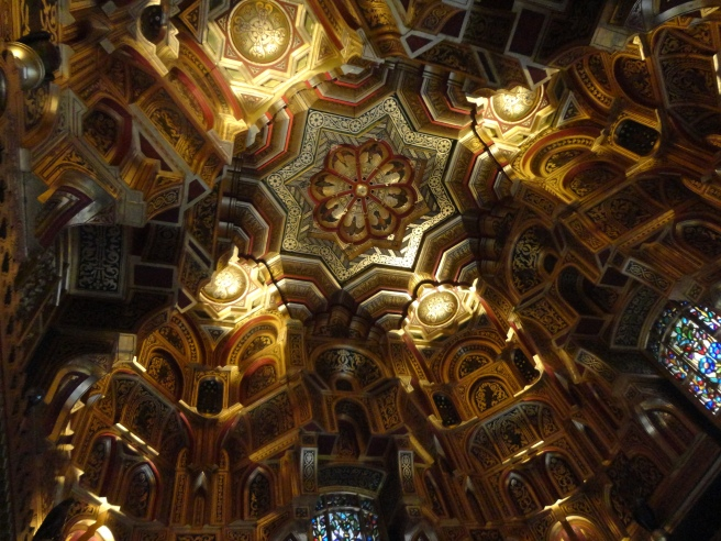 The ceiling of the Arab room, carved wood painted in gold.