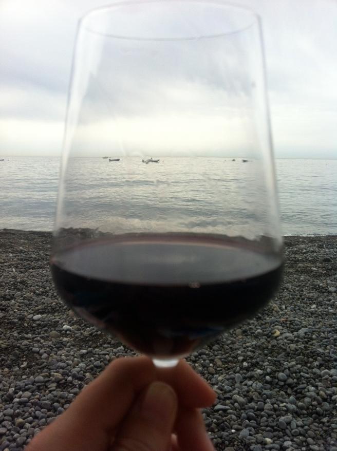 Enjoying a glass of wine on the beach.